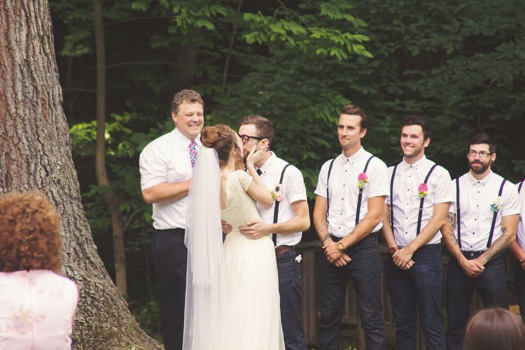 Outdoor Ceremony Bride Groom Kiss Groomsmen Celebrant Tree Artistic Whimsical Woodland Wedding http://www.adlivcollective.com/