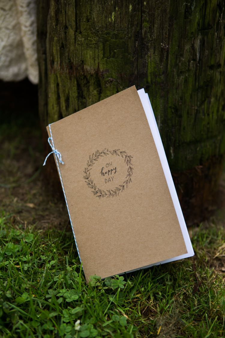 Ceremony Booklet Blue Ribbon Cardboard Tree Grass Artistic Whimsical Woodland Wedding http://www.adlivcollective.com/
