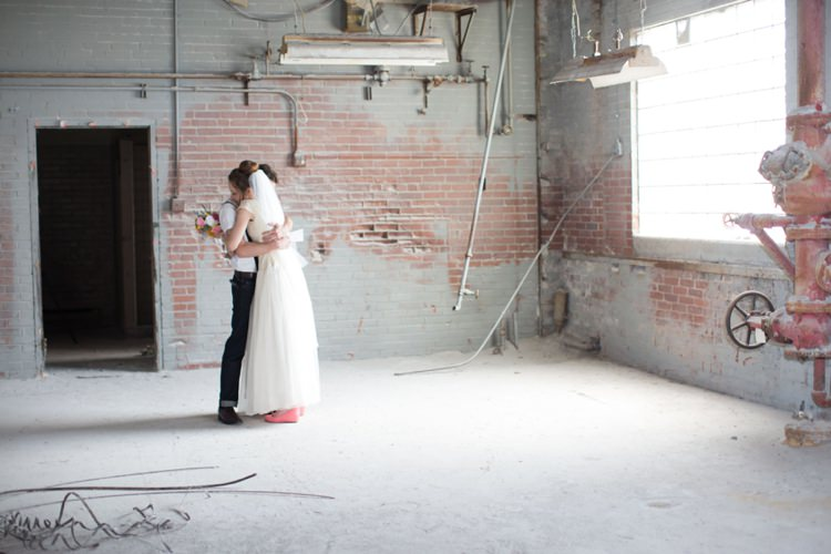 First Look Groom Bride Hug Warehouse Artistic Whimsical Woodland Wedding http://www.adlivcollective.com/
