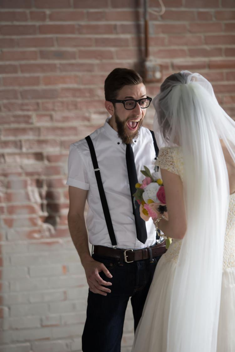 First Look Groom White Shirt Suspenders Black Tie Jeans Glasses Bride Veil Felt Floral Bouquet Artistic Whimsical Woodland Wedding http://www.adlivcollective.com/