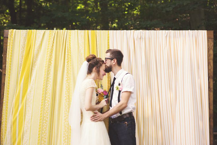 Bride Cap Sleeve Beaded Bridal Gown Veil Felt Floral Bouquet Anemone Pink Green Yellow Blue Groom White Shirt Black Suspenders Tie Felt Button Hole Jeans Glasses Yellow Curtain Trees Artistic Whimsical Woodland Wedding http://www.adlivcollective.com/