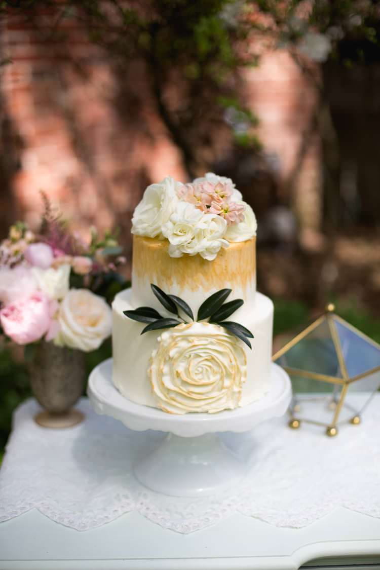 Wedding Cake Gold Cream Flowers Roses Leaves White Cake Stand Gold Pentagon Pink Florals Romantic Vintage Wedding Ideas http://katymurrayphotography.com/