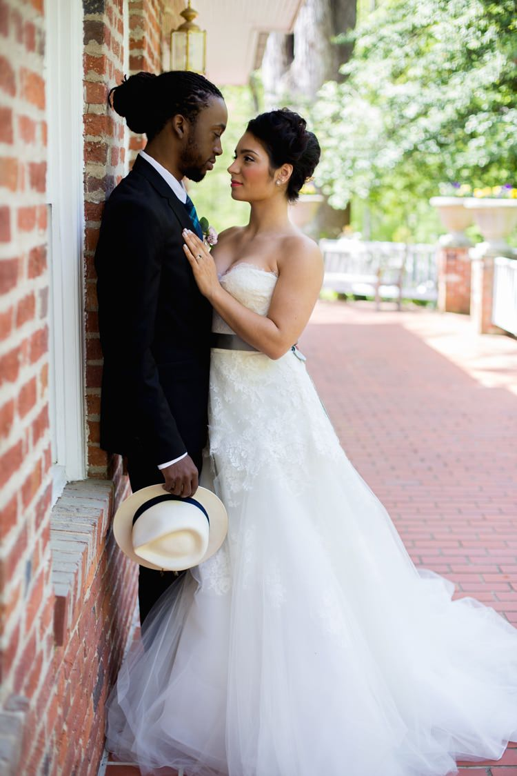 Groom Black Suit Blue Check Tie White Fedora Bride Strapless Lace Tulle Gown Sage Sash Bricks Outdoors Romantic Vintage Wedding Ideas http://katymurrayphotography.com/