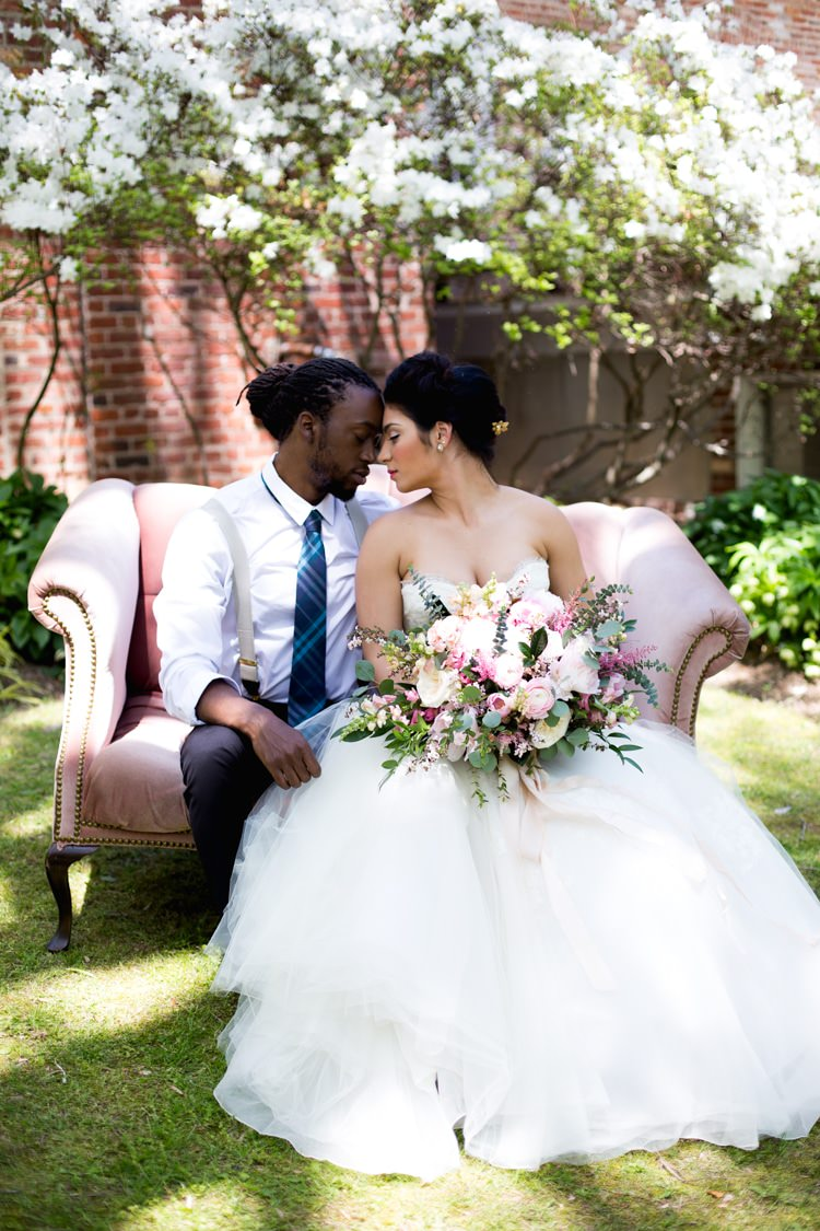 Groom Blue Striped Tie Suspenders Bride Strapless Lace Tulle Gown Pink Green Bouquet Peonies Tea Roses Eucalyptus Florals Blush Sofa Outdoors Azaleas Romantic Vintage Wedding Ideas http://katymurrayphotography.com/