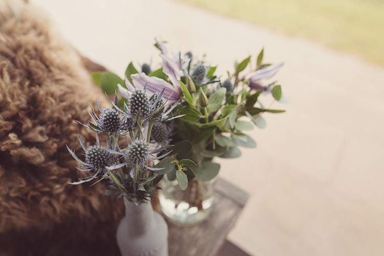 Bottle Flowers Foliage Thistles Quirky Rustic Natural Winter Wedding http://www.rebeccadouglas.co.uk/