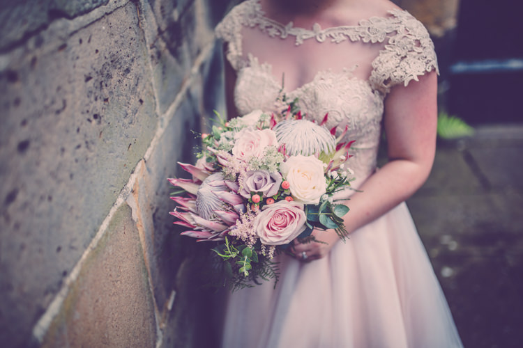 Bride Bridal Bouquet Flowers Protea Pastel Pink Roses Alternative Game of Thrones Fete Wedding http://hayleybaxterphotography.com/