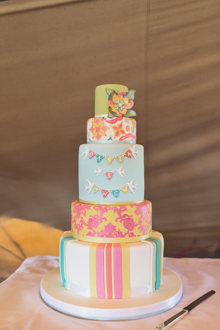 Colourful Pastel Bunting Cake Stripes Flowers DIY Tipi Camping Wedding http://www.wearetheclarkes.com/