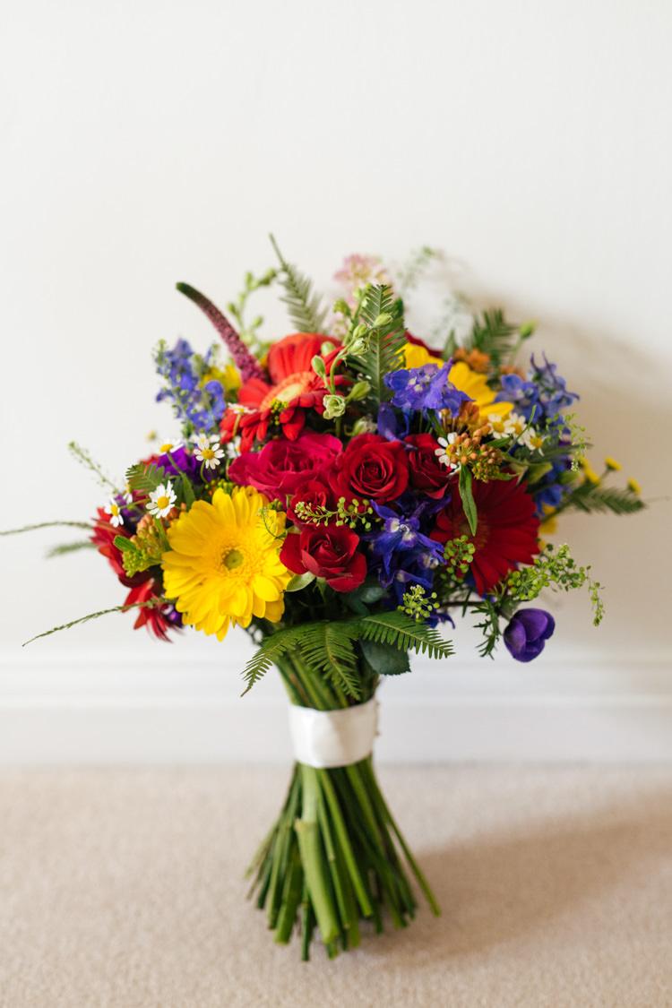 Bouquet Flowers Bride Bridal Rainbow Roses Gerbera Red Yellow Blue Multicoloured Fun Creative Wedding http://www.catlaneweddings.com/