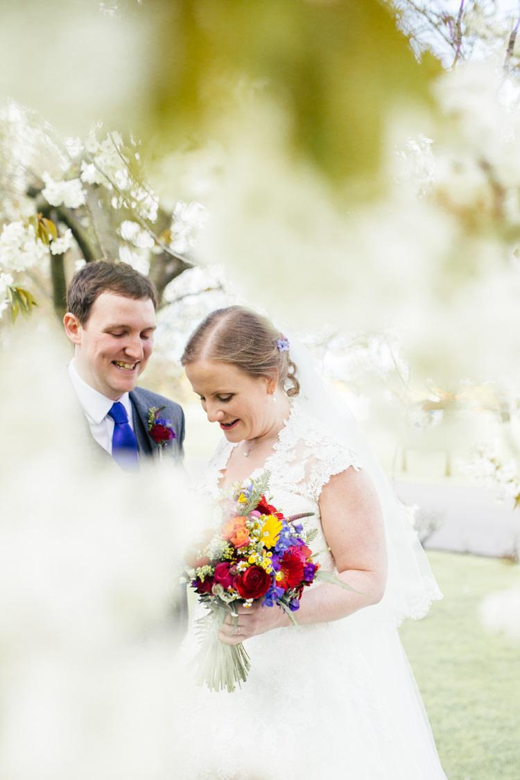 Cherry Blossom Bride Groom White Flowers Tree Multicoloured Fun Creative Wedding http://www.catlaneweddings.com/