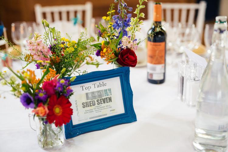 Colourful Bottle Flowers Decor Centrepiece Multicoloured Fun Creative Wedding http://www.catlaneweddings.com/