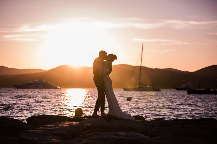 Beach Sunset Bride Groom Kiss Boats St Tropez Destination Wedding http://www.gemmamcauleyphotography.com/