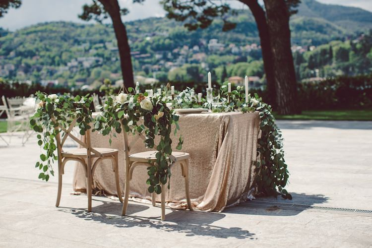 Table Setting Champagne Sequin Tablecloth Cream Blush Roses Greenery Decorated Chairs Flowers Candlesticks Vila Geno Venue Breathtaking Lake Como Wedding Ideas http://lillyred.it/