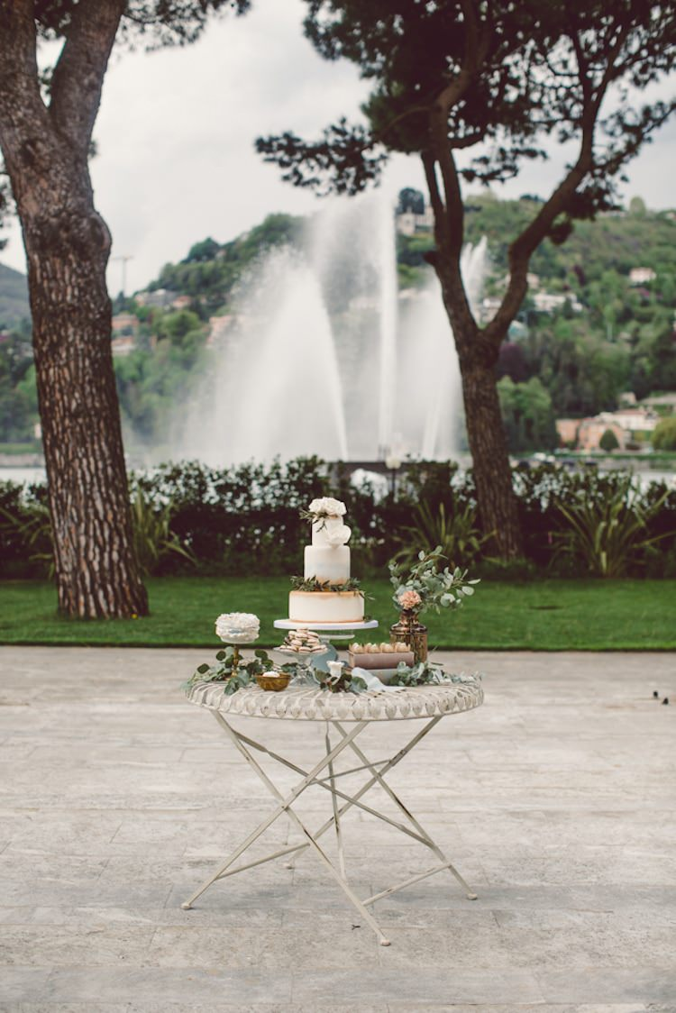 Dessert Table Gold Cream Blue Wedding Cake Roses Green Leaves Groom Cake Sweet Treats Cream Blush Roses Greenery Flowers Water Fountain Trees Breathtaking Lake Como Wedding Ideas http://lillyred.it/