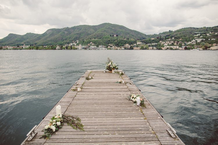 Outdoor Ceremony Idea Pier Lake Flowers Cream Blush Roses Greenery Candles Mountain View Breathtaking Lake Como Wedding Ideas http://lillyred.it/