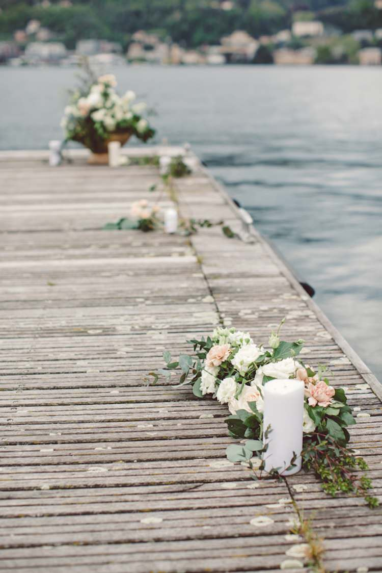 Outdoor Ceremony Idea Pier Lake Flowers Cream Blush Roses Greenery Candles Breathtaking Lake Como Wedding Ideas http://lillyred.it/