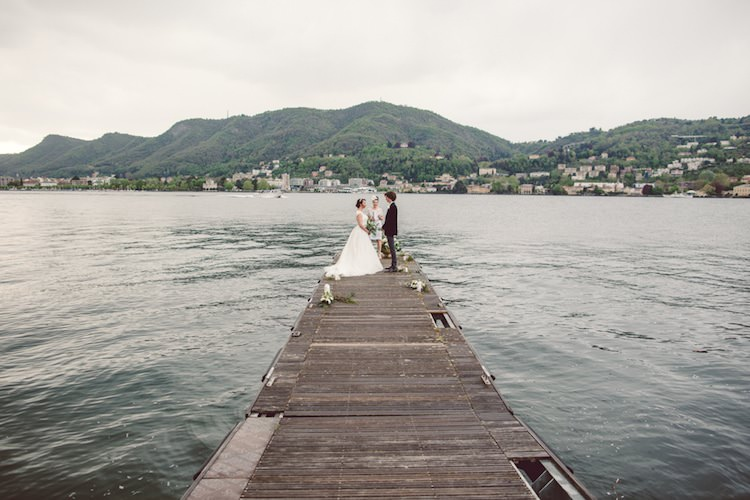 Outdoor Ceremony Idea Pier Lake Bride Groom Officiant Mountain Views Flowers Candles Breathtaking Lake Como Wedding Ideas http://lillyred.it/