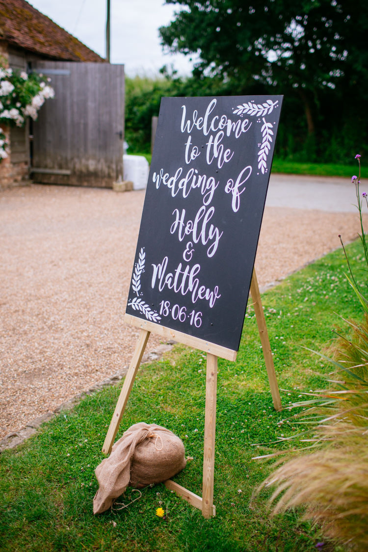 Black Chalk Board Sign DIY Easel Whimsical Peaches Mint Stylish Floral Wedding http://www.sarahleggephotography.co.uk/