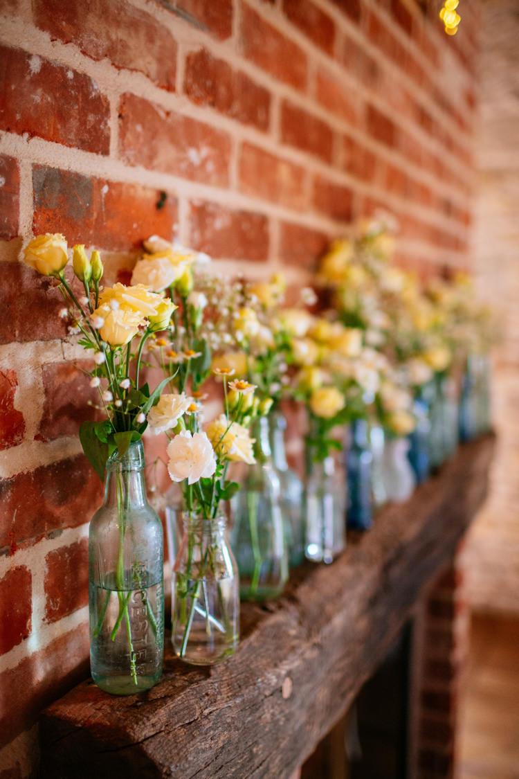 Bottles Flowers Mantle Piece Decor Peaches Mint Stylish Floral Wedding http://www.sarahleggephotography.co.uk/