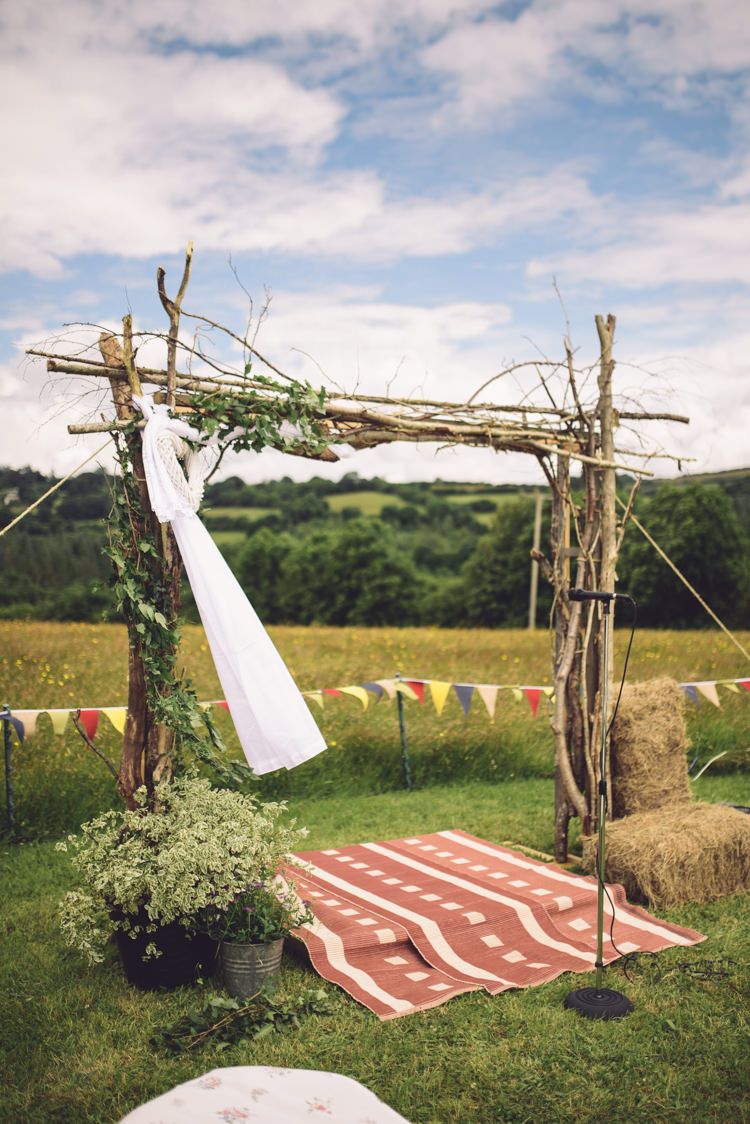 Arch Backdrop Ceremony Aisle Branch Tree Wood Outdoor Countryside Fair Wedding http://www.jennawoodward.com/