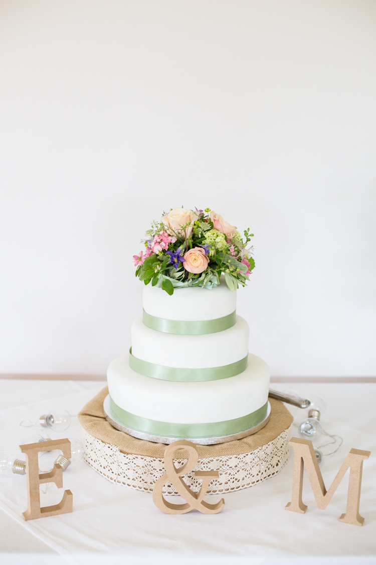 Cake Green Ribbon Flower Topper Table DIY Steam Railway Village Hall Wedding http://www.charlotterazzellphotography.com/