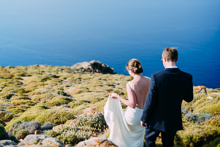 Bride Backless Bridal Gown Groom Green Grass Hill Ocean View Breathtaking Intimate Mykonos Destination Wedding http://www.annapumerphotography.com/