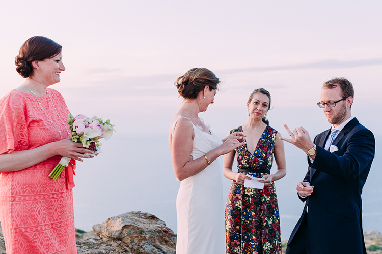 Outdoor Ceremony Bride Backless Bridal Gown Groom Navy Suit Blue Striped Tie Celebrant Breathtaking Intimate Mykonos Destination Wedding http://www.annapumerphotography.com/