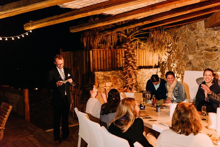 Reception Groom Navy Suit Blue Striped Tie Speeches Bride Denim Jacket Guests Fairy Lights Breathtaking Intimate Mykonos Destination Wedding http://www.annapumerphotography.com/