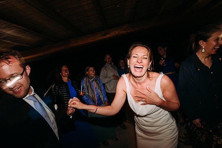 Reception Dancing Bride Backless Bridal Gown Groom Navy Suit Blue Striped Tie Guests Breathtaking Intimate Mykonos Destination Wedding http://www.annapumerphotography.com/