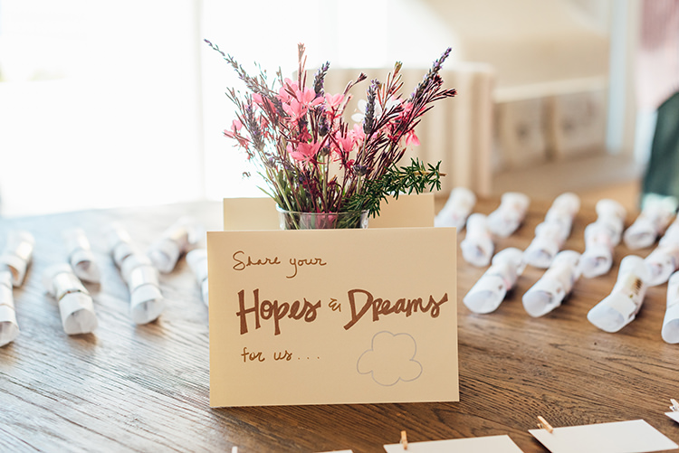 Hopes and Dreams Sign Cards Pegs Pink Purple Flowers Vase Party Crackers Breathtaking Intimate Mykonos Destination Wedding http://www.annapumerphotography.com/