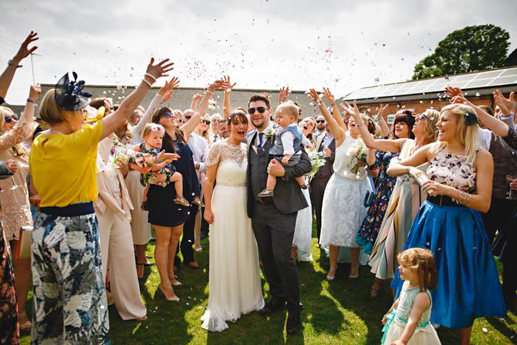 Confetti Throw Bride Groom Casual Festival Feel Barn Wedding http://hbaphotography.com/