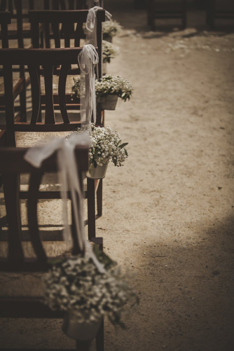 Ceremony Wooden Chairs Gypsophila Metal Buckets White Ribbons Atmospheric Abbey Tuscany Wedding http://www.angelicabraccini.com/