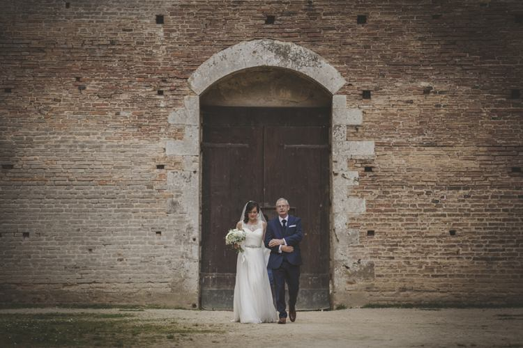 Outdoor Ceremony Bride Lace Sleeveless Bridal Gown Veil Bouquet Father Wooden Door Brick Building Atmospheric Abbey Tuscany Wedding http://www.angelicabraccini.com/