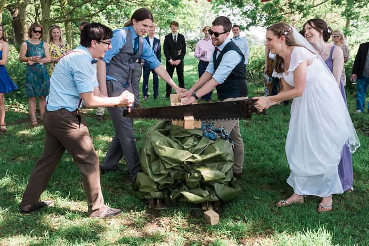 Log Cutting Bride Groom Outdoor DIY Farm Wedding http://www.markewelsphotography.com/