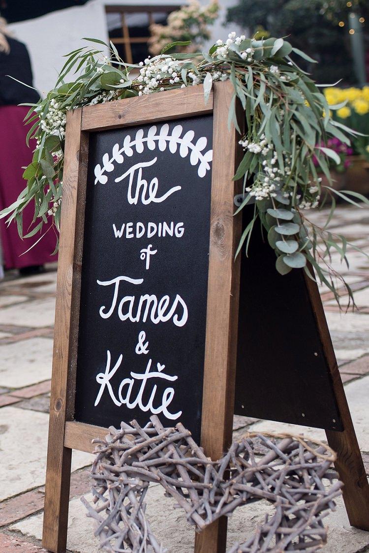 Black Chalk Board Sign Foliage Greenery Stylish Floral Barn Wedding http://www.sarareeve.com/