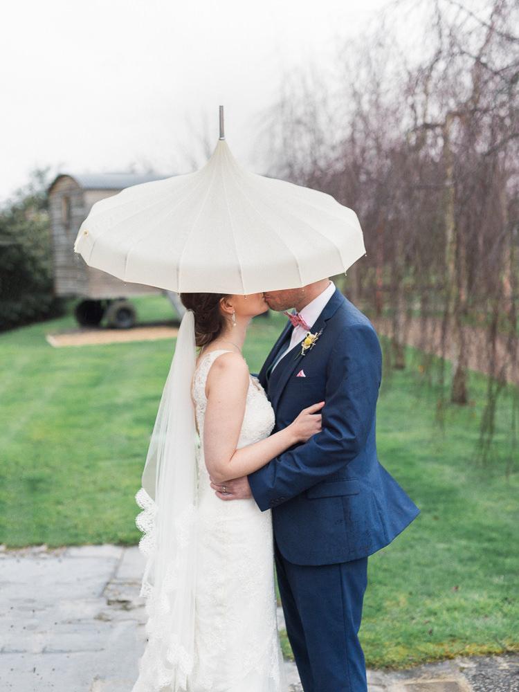 Rainy Umbrella Bride Groom Pretty Home Made Pastel Floral Wedding http://www.stephanieswannweddings.co.uk/