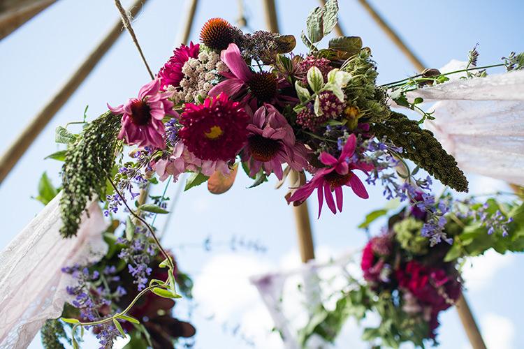 Hanging Flowers Tipi Circle Alternative Colourful Boho Wedding Ideas http://www.binkynixon.com/