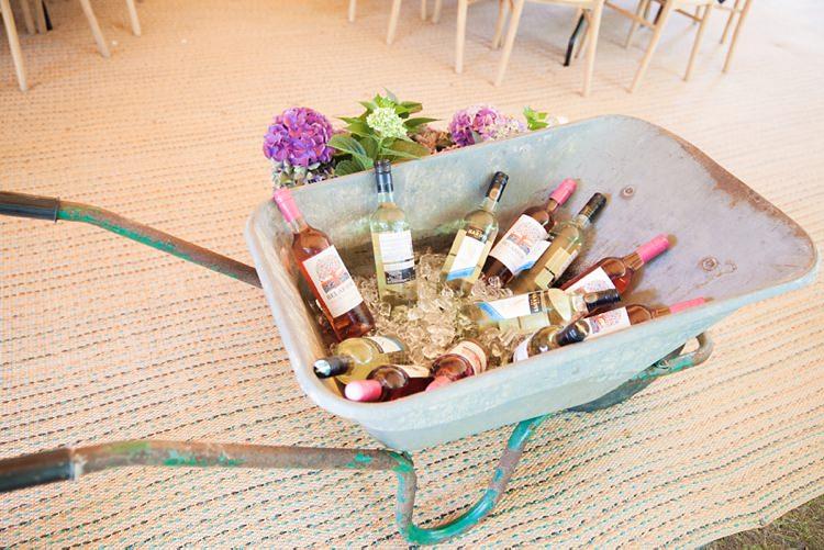 Wheelbarrow Drinks Wine Bottles Pink Rustic Tipi Woodland Wedding http://kerryannduffy.com/