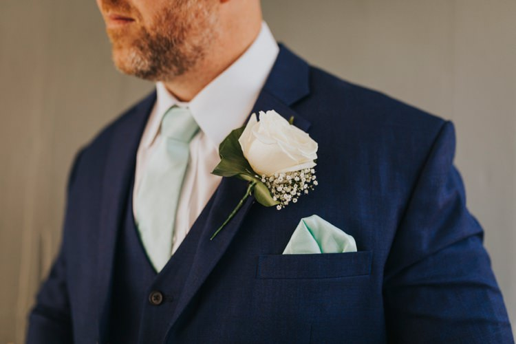 White Rose Buttonhole Mint Tie Groom Creative Festival Wedding http://benjaminstuart.co.uk/