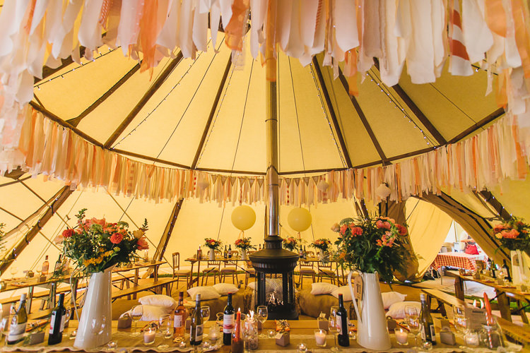 Coral Peach Rag Bunting Outdoorsy Colourful Tipi Wedding http://www.tierneyphotography.co.uk/