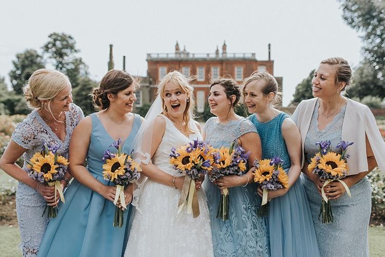 Mismatched Blue Bridesmaid Dresses City Farm Yellow Blue Wedding http://www.baiandelle.com/
