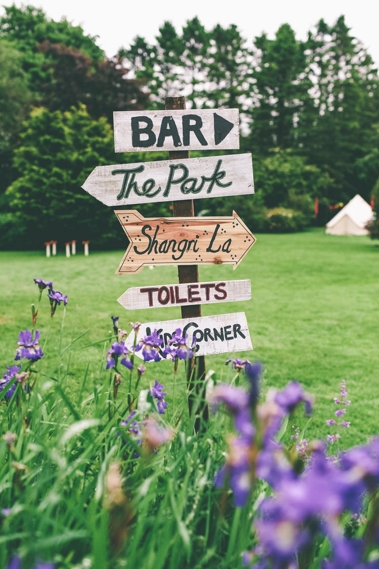 Wooden Rustic Sign Post Home Made Glastonbury Festival Wedding http://www.emmaboileau.co.uk/