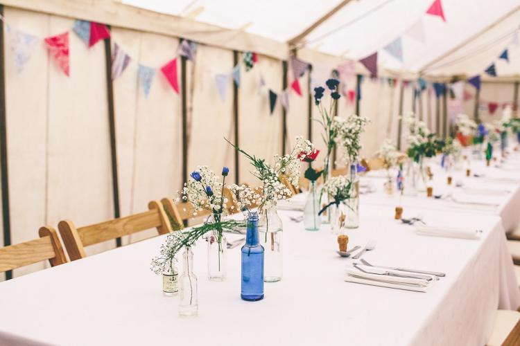 Flowers Bottles Long Tables Home Made Glastonbury Festival Wedding http://www.emmaboileau.co.uk/