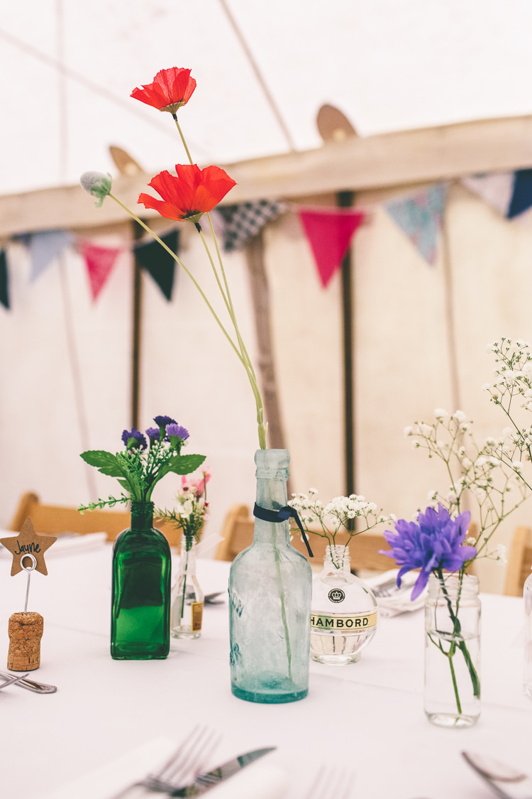 Poppies Bottle Flowers Centrepiece Decor Home Made Glastonbury Festival Wedding http://www.emmaboileau.co.uk/