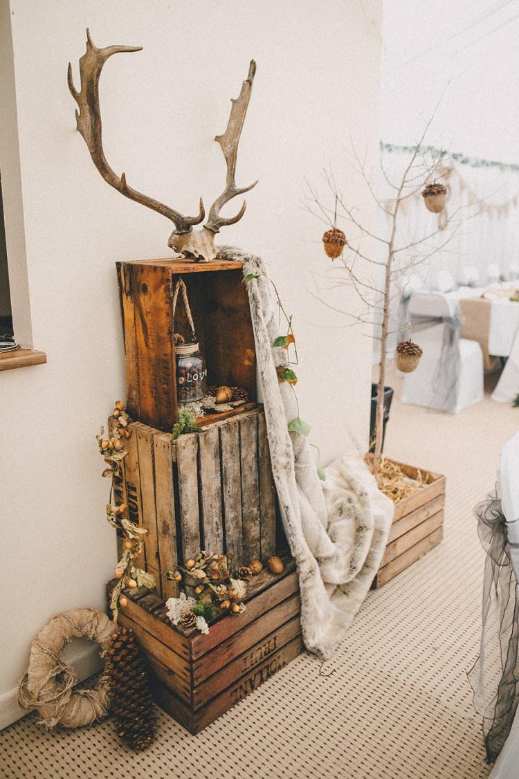 Crate Decor Antler Fur Pine Cones Woodland Inspired Autumn Wedding http://www.kerrydiamondphotography.com/