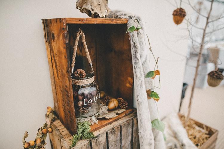 Crate Decor Antler Pine Cones Fur Woodland Inspired Autumn Wedding http://www.kerrydiamondphotography.com/