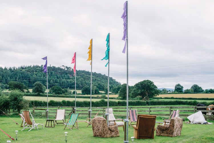Festival Flags Rustic Seating Big Top Farm Party Wedding http://www.robinstudios.com/