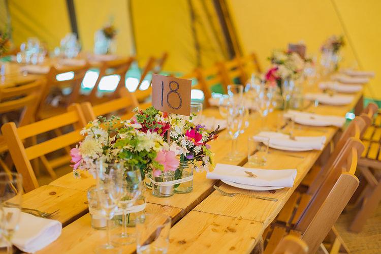 Jar Flowers Rustic Tables Fun & Games Tipi Wedding http://jamesandlianne.com/