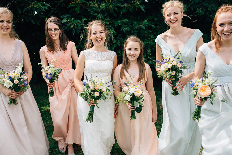 DIY Pastel Bridesmaid Dresses Floral Marquee Summer Wedding http://matildadelvesweddingphotography.com/