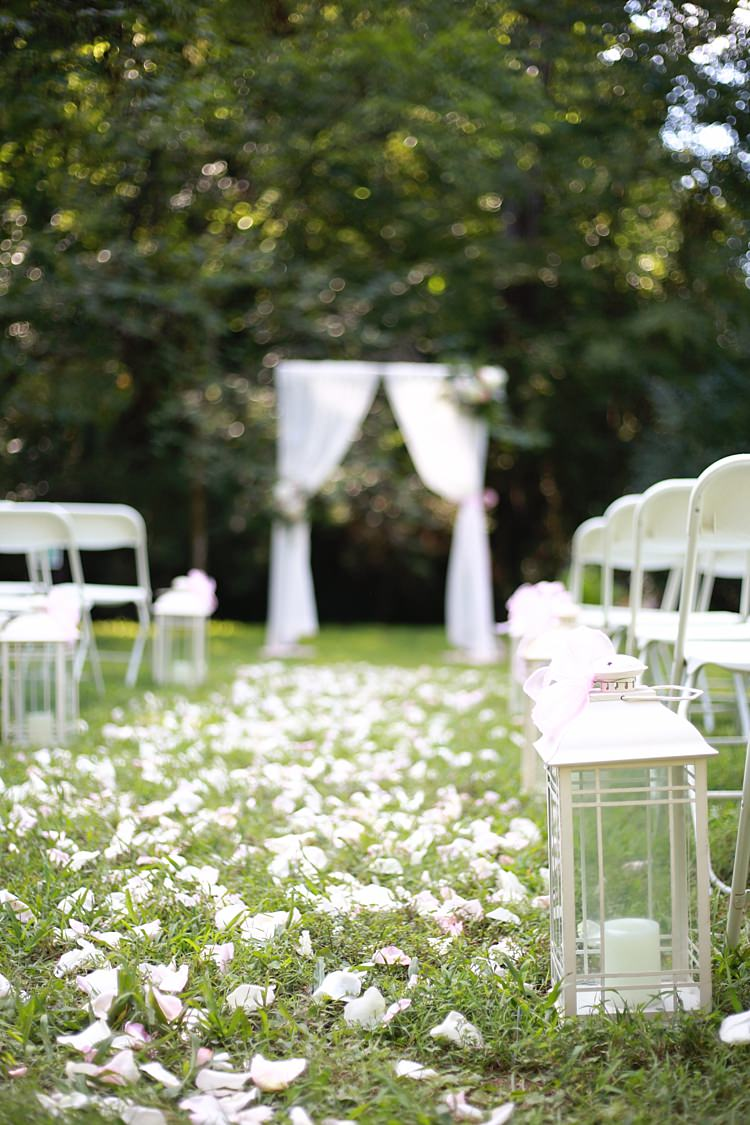 Outdoor Ceremony White Curtains Glass Candle Lantern Flower Petals White Chairs Soft Romantic Woodland Wedding Tennessee http://www.jessicaleephotographicart.com/