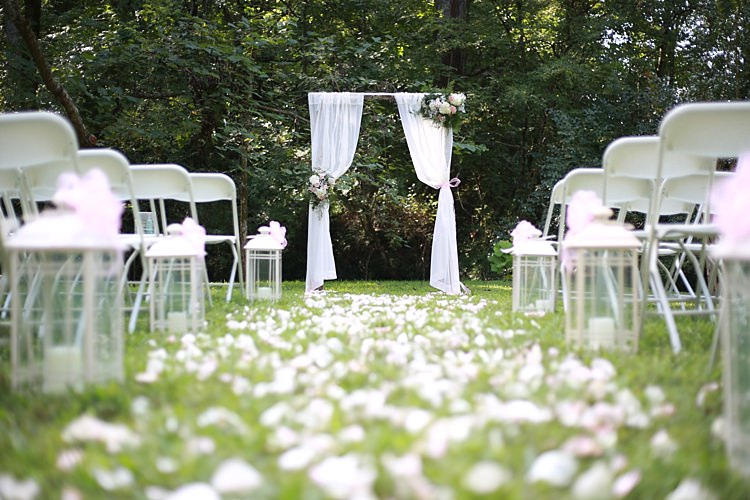 Outdoor Ceremony White Curtains Floral Bouquets Glass Candle Lantern Flower Petals White Chairs Soft Romantic Woodland Wedding Tennessee http://www.jessicaleephotographicart.com/